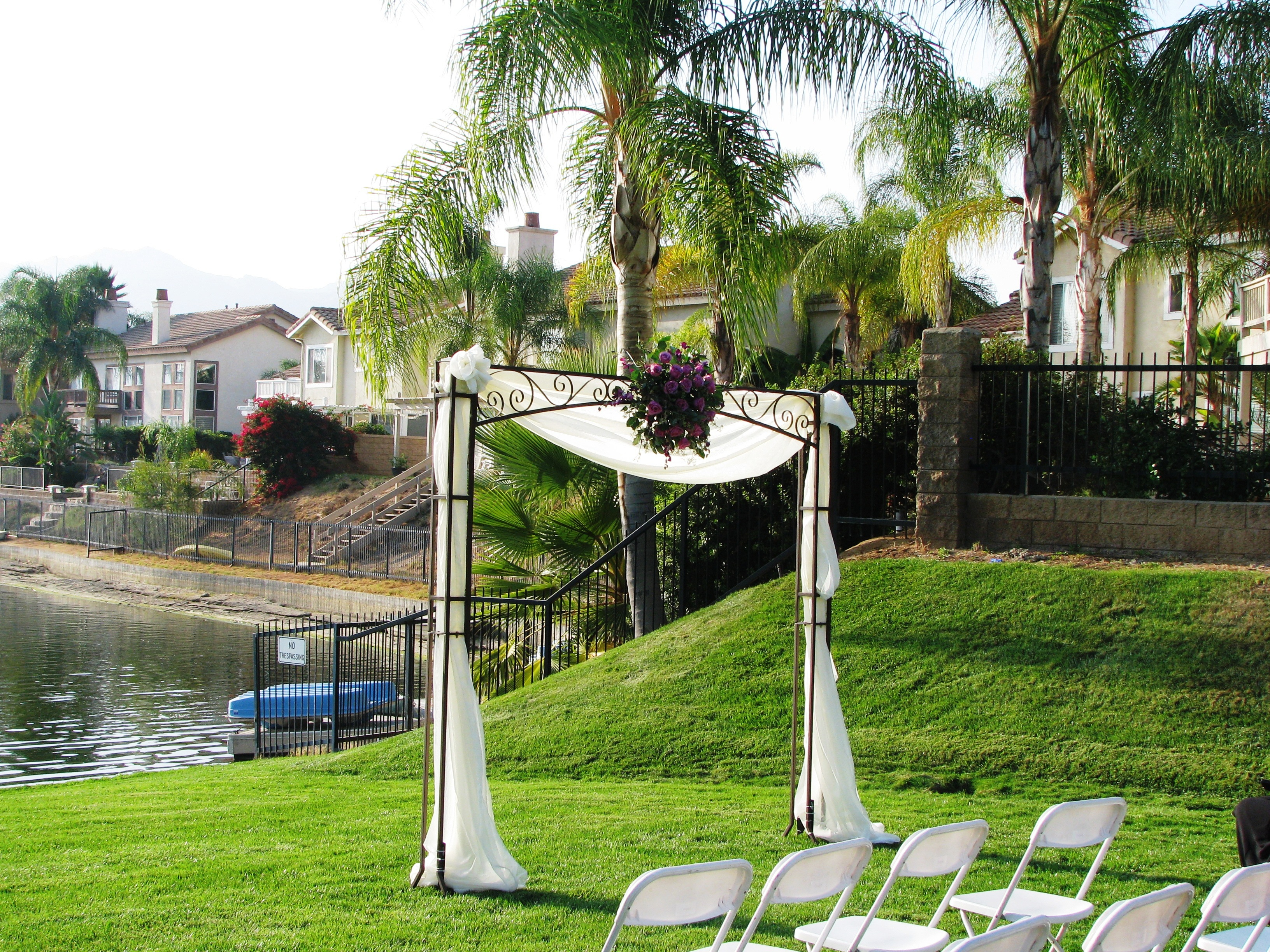 iron square arch with draping and flower jpg